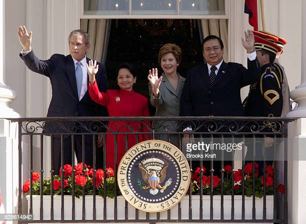 US President George W Bush hosts a State Arrival for Philippine President Gloria MacapagalArroyo with First Lady Laura Bush and Mr Jose Miguel T...