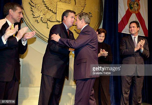 President George W Bush hugs his brother Jeb before speaking at a Jeb Bush for Florida Governor fundraising event 09 January 2002 at the Capitol...