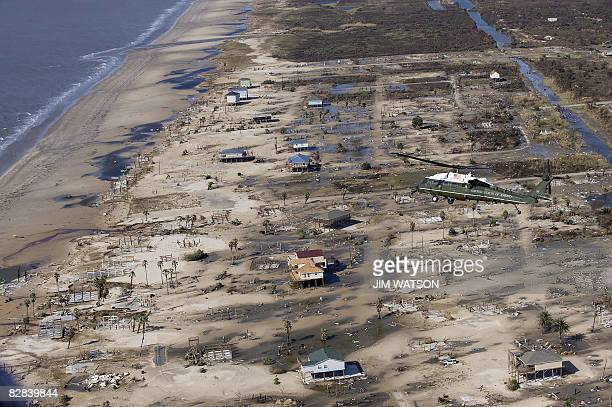 US President George W Bush in Marine One flies over a damaged residential area near Galveston Texas while touring Hurricane Ike damage with Texas...