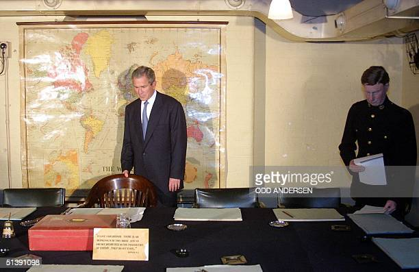 President George W. Bush inspects the seat of Winston Churchill in the Cabinet War Rooms in London, 19 July 2001. The American President is on a...