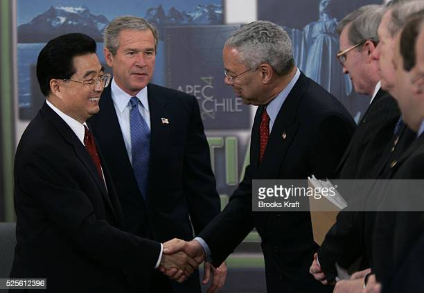 US President George W Bush introduces Chinese President Hu Jintao to members of his cabinet including Secretary of State Colin Powell following their...