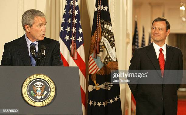 President George W. Bush introduces his new Chief Justice of the U.S., John Roberts, during a swearing in ceremony in the East Room at the White...