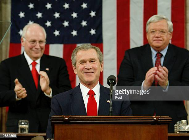 S President George W Bush is applauded by Vice President Dick Cheney and House Speaker Dennis Hastert as he begins his State of the Union address on...