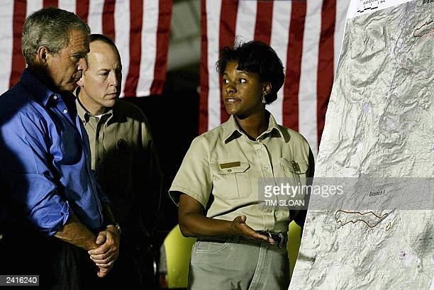 President George W. Bush is given a fire briefing along with Rep. Greg Walden from Leslie Weldon, Forest Supervisor of Deschutes National Forest 21...