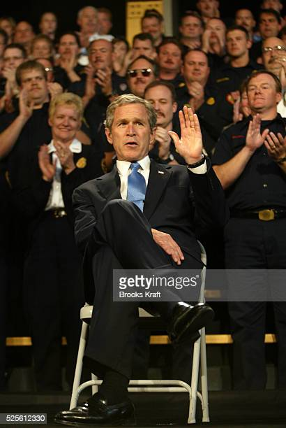 President George W Bush is given a standing ovation by emergency workers during an event in Atlanta Georgia President Bush is on a tour promoting his...