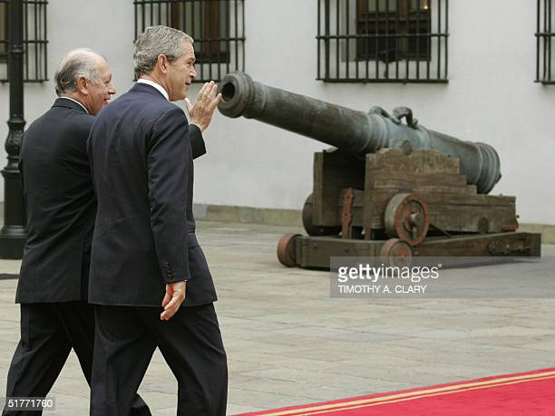 President George W Bush is greeted by Chilean President Ricardo Lagos as he arrives at the La Moneda Palace in Santiago Chile 21 November 2004 Bush...