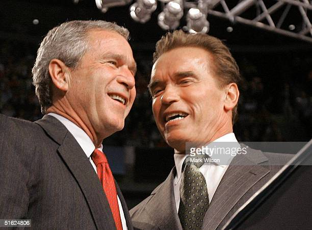 S President George W Bush is introduced by California Governor Arnold Schwarzenegger during a campaign rally at Nationwide Arena October 29 2004 in...
