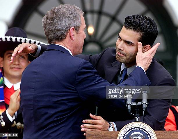 President George W Bush is introduced by his nephew George P Bush during a celebration of the mexican traditional holiday of Cinco De Mayo on a South...