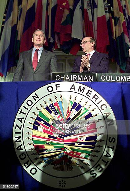 President George W Bush is welcomed to the Organization of American States by the Chairman Humberto de la Calle at the OAS building 17 April 2001 in...