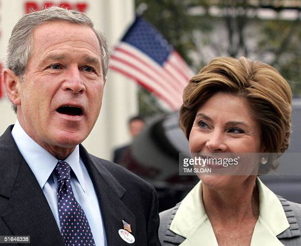 President George W Bush joined by First Lady Laura Bush talks with the press after voting at the Crawford Volunteer Fire Department 02 November 2004...