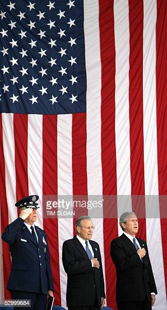 President George W. Bush joined by Secretary of Defense Donald Rumsfeld and Chairman of the Joint Chiefs, General Richard Myers salute during the...