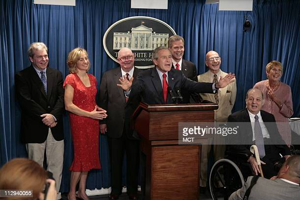 President George W. Bush jokes with the media in the press briefing room in the West Wing of the White House Wednesday, August 2, 2006 in Washington,...