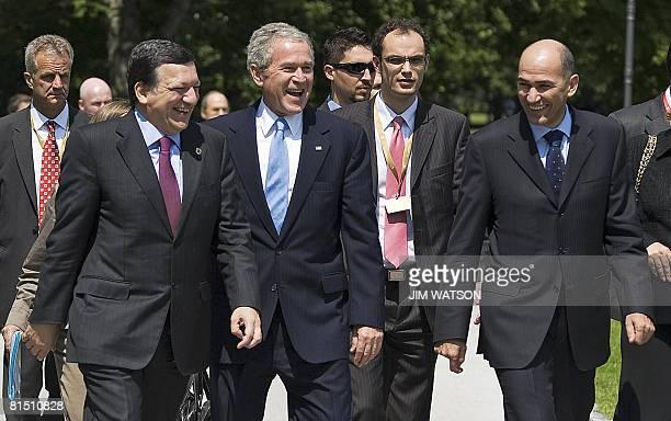 US President George W Bush jopkes with Slovenian Prime Minister Janez Jansa and European Union Commission President Jose Manuel Barroso as they...