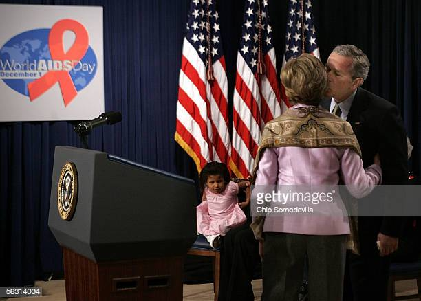 S President George W Bush kisses First Lady Laura Bush after she delivered remarks on World AIDS Day December 1 2005 in the Eisenhower Executive...