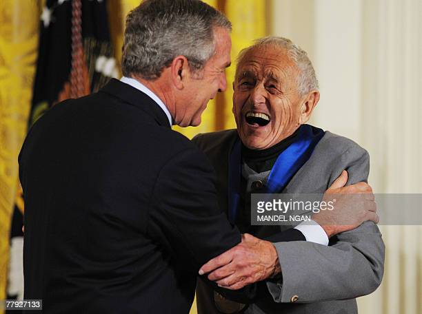 US President George W Bush laughs with painter Andrew Wyeth after presenting him with the 2007 National Medal of Arts 15 November 2007 in the East...