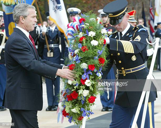 S President George W Bush lays a wreath at the Tomb of the Unknown Soldier during a ceremony commemorating Veterans Day at Arlington National...