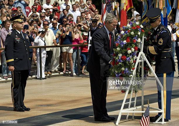 US President George W Bush lays a wreath at the Tomb of the Unknown Soldier during the Arlington National Cemetary Memorial Day Commemoration in...