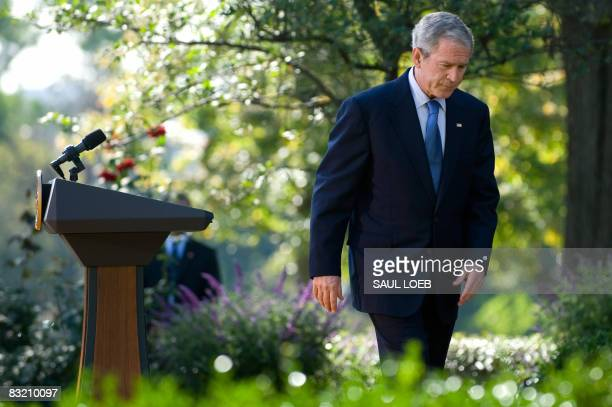 US President George W Bush leaves after speaking on the status of the US and global economy in the Rose Garden of the White House in Washington DC on...