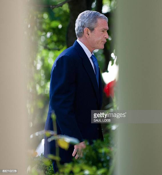 US President George W Bush leaves afters speaking on the status of the US and global economy in the Rose Garden of the White House in Washington DC...