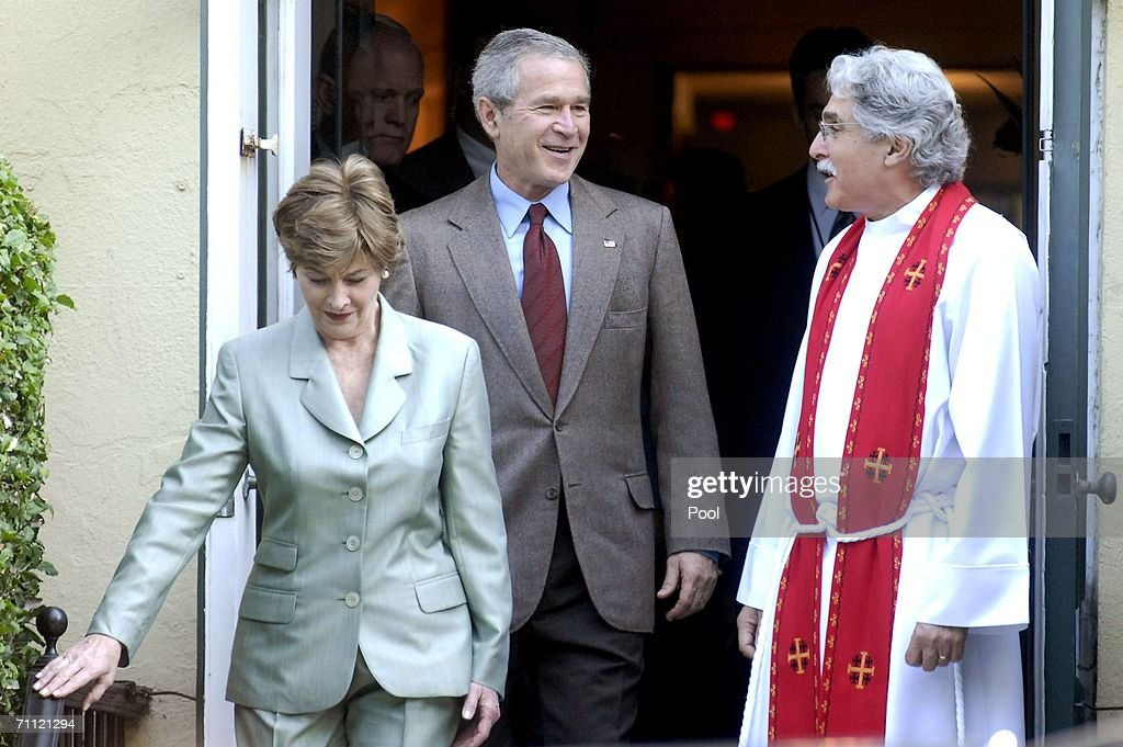U.S. President George W. Bush (C) leaves St. John's Episcopal Church with Rev. Luis Leon (R) and first Lady Laura Bush (L) after a Sunday service June 4, 2006 in Washington, DC.
