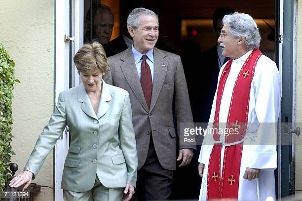 S President George W Bush leaves St John's Episcopal Church with Rev Luis Leon and first Lady Laura Bush after a Sunday service June 4 2006 in...