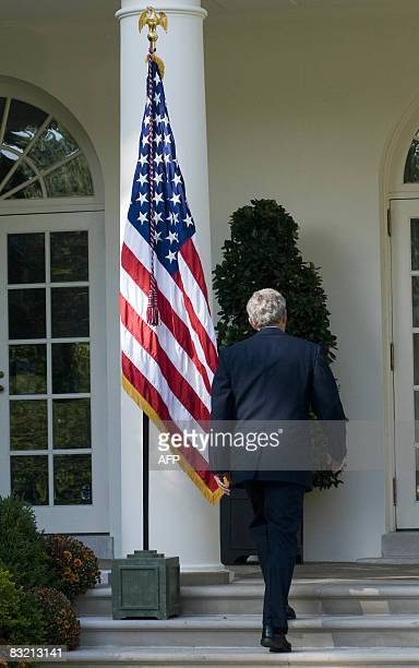 US President George W Bush leaves the Rose Garden after he spoke on the status of the US and global economy at the White House in Washington DC on...