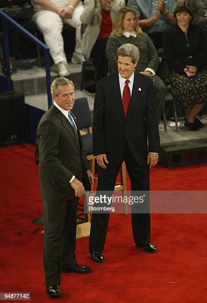 S President George W Bush left acknowledges his opponent Senator John Kerry at the conclusion the second of three presidential debates October 8 2004...