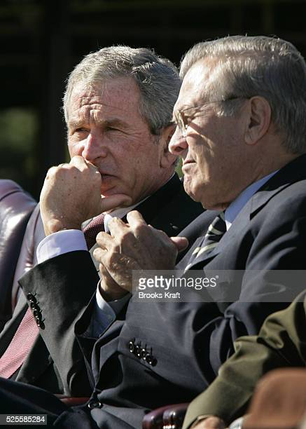 President George W. Bush, left, and Secretary of Defense Donald Rumsfeld watch a flyover during an Armed Forces farewell tribute in honor of Chairman...