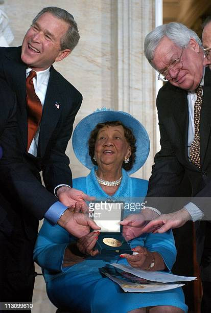 WASHINGTON DC President George W Bush left and Speaker of the House Dennis Hastert pose with civil rights activist Dr Dorothy Height at a ceremony...