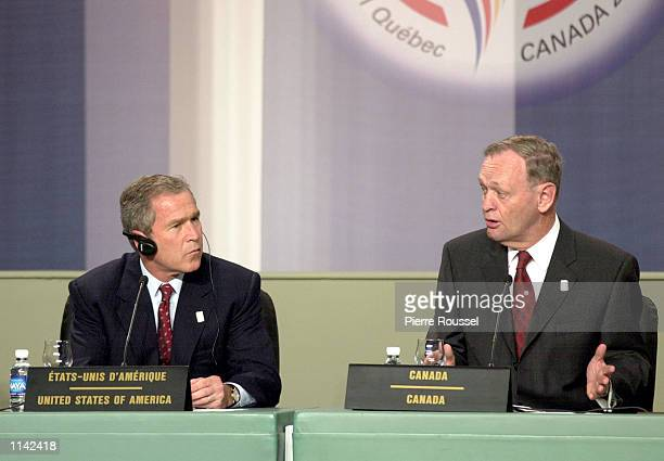 President George W. Bush, left, listens to Canadian Prime Minister Jean Chretien's remarks in French April 22, 2001 at the press conference following...