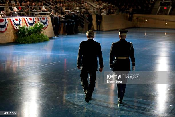 S President George W Bush left walks toward his seat after reviewing troops during the Military Appreciation Parade at Fort Myer in Arlington...