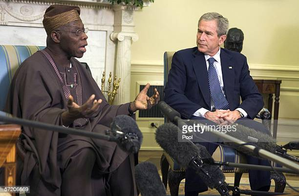 US President George W Bush listens as the President of Nigeria Olesegun Obasanjo speaks while in the Oval Office of the White House March 29 2006 in...