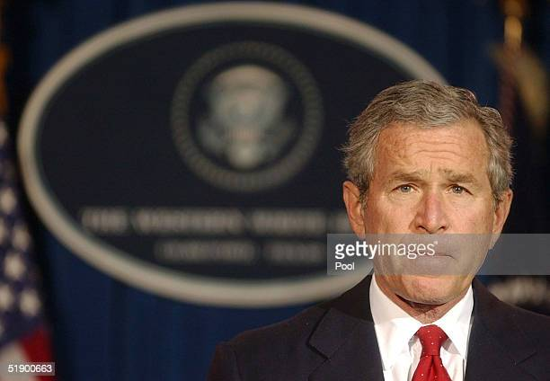 US President George W Bush listens to a question during a news conference at his ranch December 29 2004 near Crawford Texas President Bush spoke on a...