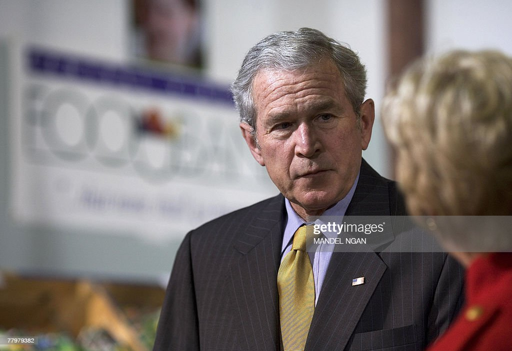 US President George W  Bush listens to Central Virginia Food
