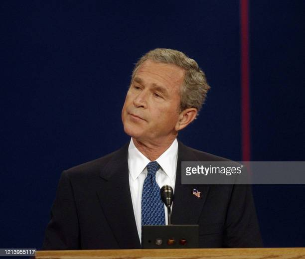 President George W. Bush listens to Democratic presidential candidate John Kerry during the first debate of the 2004 White House race at the...