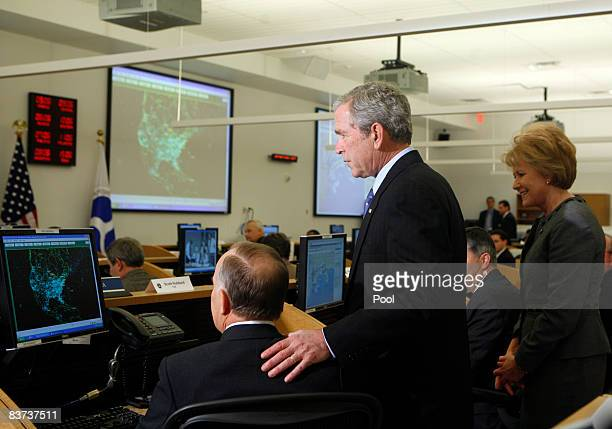 US President George W Bush listens to Scott Hubbard during a visit to the US Department of Transportation with Mary E Peters Secretary of...