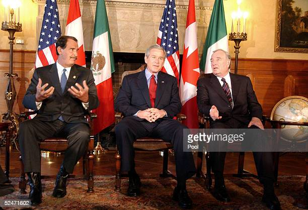 S President George W Bush listens while sitting with Mexican President Vicente Fox and Canadian Prime Minister Paul Martin March 23 2005 at Baylor...