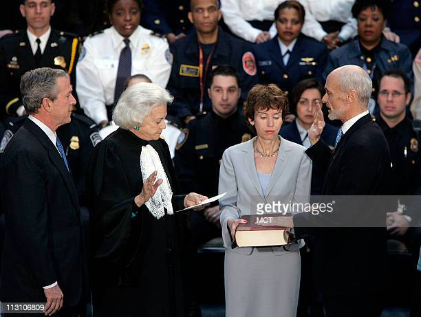 WASHINGTON DC US President George W Bush looks on as US Supreme Court Justice Sandra Day O'Connor swearsin new US Department of Homeland Security...