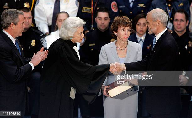 WASHINGTON DC US President George W Bush looks on as US Supreme Court Justice Sandra Day O'Connor congratulates new US Department of Homeland...