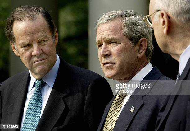 President George W Bush makes a few remarks after meeting with the Thomas Kean and Lee Hamilton members of the Independent Commission investigating...