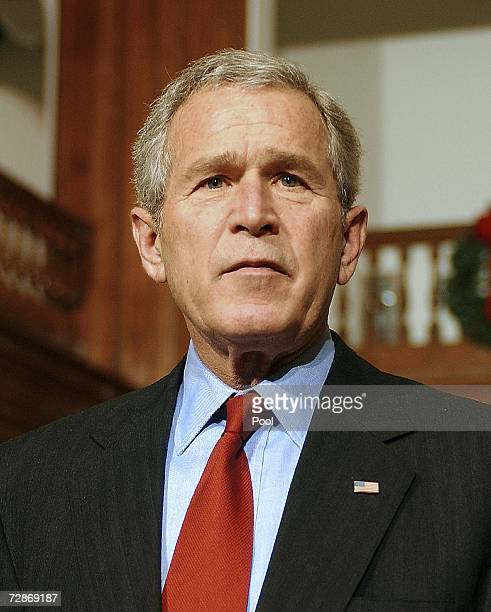 US President George W Bush makes a statement after he and first lady Laura Bush helped wrap Christmas gifts destined for injured soldiers and their...