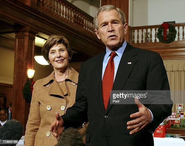 US President George W Bush makes a statement next to first lady Laura Bush after helping wrap Christmas gifts destined for injured soldiers and their...