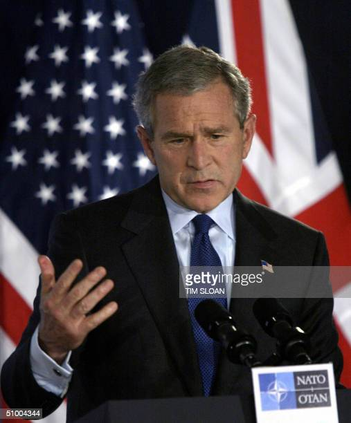 President George W Bush makes remarks at a press conference given by him and British Prime Minister Tony Blair to talk about today's surprise turn...