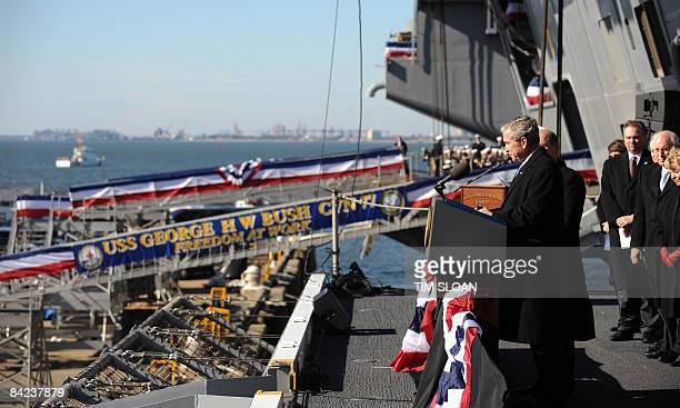 US President George W Bush makes remarks during the Commissioning Ceremony of the USS George HW Bush a Nimitz Class nuclear aircraft carrier on...
