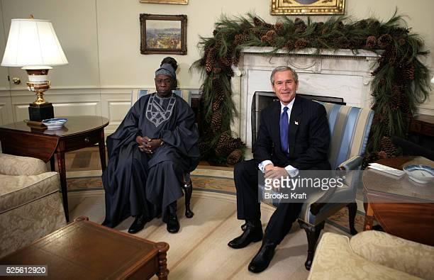 US President George W Bush meets the President of Nigeria Olusegun Obasanjo in the Oval Office on November 29 2004