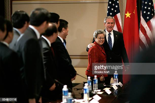 US President George W Bush meets with Chinese Vice Premier Wu Yi in the Eisenhower Executive Office Building across from the White House in...