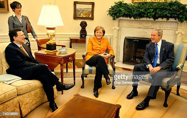 S President George W Bush meets with European Commission President Jose Manuel Barroso and German Chancellor Angela Merkel in the Oval Office at the...