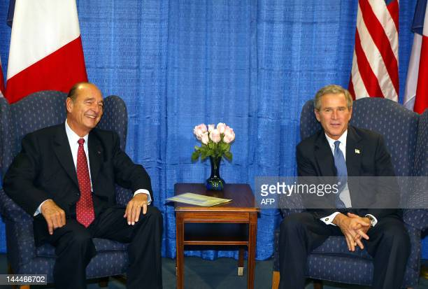 President George W. Bush meets with France's President Jacques Chirac at the US Mission to the United Nations 23 September, 2003. Both leaders spoke...