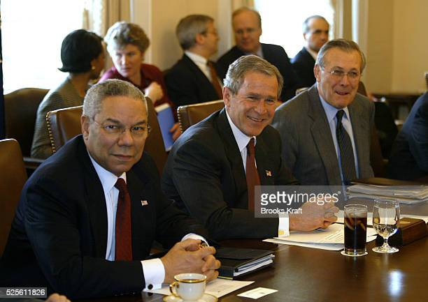 President George W. Bush meets with his cabinet at the White House, including Secretary of State Colin Powell and Secretary of Defense Donald...