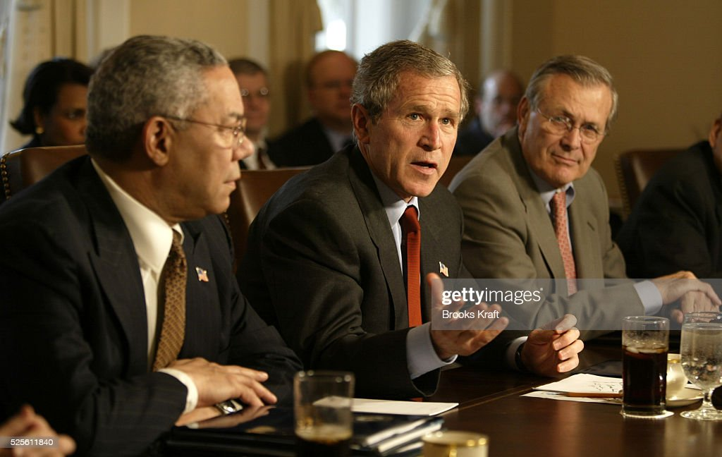 President George W. Bush (C) meets with his cabinet at the White House, including Secretary of State Colin Powell (L) and Secretary of Defense Donald Rumsfeld (R). Behind them is National Security Advisor Condoleezza Rice.